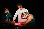 Sarah Rose, sea turtle technician for Georgia Department of Natural Resources, Mark Dodd, State Sea Turtle Program Coordinator of the Georgia Department of Natural Resources, and Bonnie Berry, University of Georgia student, record data from a nesting sea turtles on Ossabaw Island, Georgia, June 18, 2012.