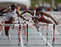 NWA Democrat-Gazette/ANDY SHUPE<br /> Arkansas' Shakiel Chattoo (right) leads Carl Elliott II as they compete Saturday, May 11, 2019, in the 110-meter hurdles during the SEC Outdoor Track and Field Championships at John McDonnell Field in Fayetteville. Visit nwadg.com/photos to see more photographs from the meet.