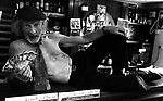 Sylvie O'Connor offers customer to strip in his pub in Ballyferriter in 1992.<br /> Picture by Don MacMonagle
