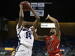 Nevada guard Lindsey Drew (14) shoots over Fresno State guard New Williams (0) during the first half of a basketball game played at Lawlor Events Center in Reno, Nev., Saturday, Feb. 22, 2020.