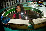 Daniela Ayala watches toy trains at the California State Railroad Museum in Sacramento, California.