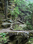 A Stone Foot Bridge And Steps Along This Quiet Walking Path In The Lush And Green Scenic Gorge Called Old Man's Cave, The Hocking Hills Region Of Central Ohio, USA