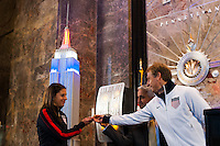 U.S. women national team midfielder Carli Lloyd, U.S. Soccer president Sunil Gulati, and U.S. men's head coach Jurgen Klinsmann flip the switch to light the Empire State Building in the Red White and Blue colors of the US Soccer Federation during the centennial celebration of U. S. Soccer in New York, NY, on April 05, 2013.
