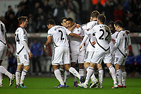 Pictured: Scott Sinclair of Swansea (C) mobbed by team mates celebrating after scoring his opening goal. Tuesday, 31 January 2012<br />