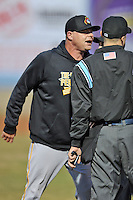 West Virginia Power pitching coach Jeff Johnson #23 argues with home plate umpire Tyler Ferguson after being ejected while first base umpire Derek Gonzalez tries to separate the two during a game against Asheville Tourists  at McCormick Field on April 9, 2014 in Asheville, North Carolina. The Tourists defeated the Power 5-3. (Tony Farlow/Four Seam Images)