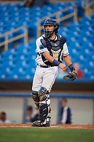 Lake County Captains catcher Jonathan Laureano (23) throws to third base after a strikeout during the first game of a doubleheader against the South Bend Cubs on May 16, 2018 at Classic Park in Eastlake, Ohio.  South Bend defeated Lake County 6-4 in twelve innings.  (Mike Janes/Four Seam Images)