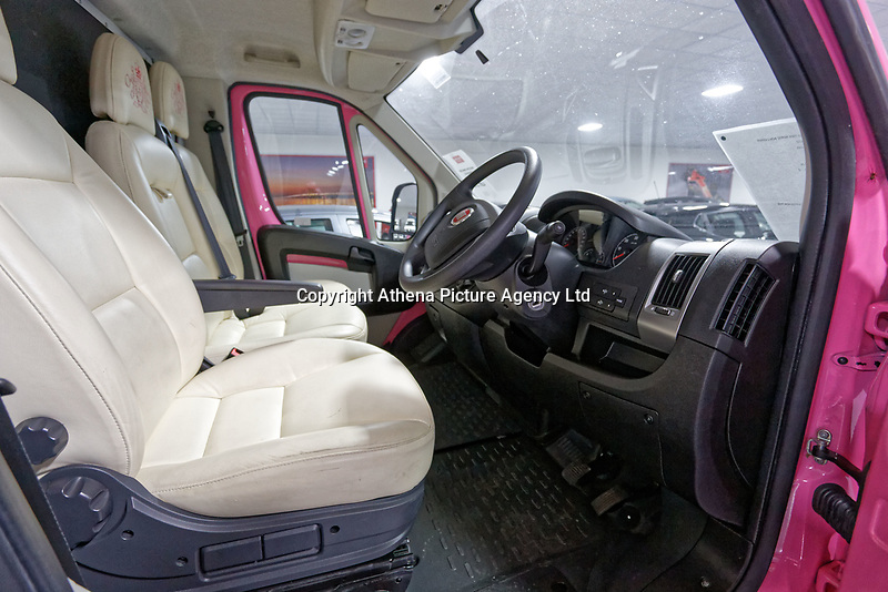 """Pictured: Interior view of the pink Fiat Ducato horsebox once owned by tv personality Katie Price.<br /> Re: A pink horsebox owned by Katie Price is up for grabs at auction after failing to sell on eBay.<br /> The 2012 registered Fiat Ducato is instead listed on the John Pye online auction site and is now at the company's depot in Port Talbot, south Wales.<br /> The vehicle has only covered 7,000 miles, with additional features EQUI-TREK SUPER SONIC HORSE BOX CARRIER.<br /> Previously owned by Model/TV celebrity Katie Price<br /> 3.5 t finished paint work in Pink by Kahn.<br /> 2 Horse carrier.<br /> Cream Leather interior.<br /> Tachograph.<br /> Aircon.<br /> Grooms Locker.<br /> Extra height partition.<br /> Skylight Roof Vent.<br /> Internal Lighting.<br /> Tinted windows.<br /> Tie Rings on external.<br /> Internal and rear reversing cameras.<br /> wireless camera system with 7"""" screen"""