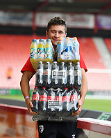 A member of the AFC Bournemouth catering staff carries bottles of drink during AFC Bournemouth vs Sheffield United, Premier League Football at the Vitality Stadium on 10th August 2019