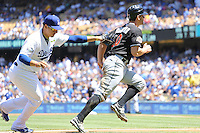 08/26/12 Los Angeles, CA: Los Angeles Dodgers third baseman Luis Cruz #47 tags out Miami Marlins Justin Ruggiano #20 during an MLB game played between the Los Angeles Dodgers and the Miami Marlins at Dodger Stadium. The Marlins Defeated the Dodgers 6-2