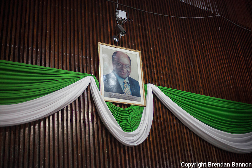 A framed portrait of Mwai Kibaki, Kenya's third president over the entrace at the press center in the Bomas of Kenya. Kenya conducted it's first national presidential election since  2007, under a new costitution.  Presidential candidate Uhuru Kenyatta was, late March 7, leading his main rival, Raila Odinga, by 49% of votes to 46%, with a final result expected early March 8. Journalists, party agents, observers and diplomats gathered at at the Bomas of Kenya, a cultural centre in the west of the capital, Nairobi, that has been turned into the national tallying centre for results from the country's March 4 elections. After technical glitches with a new electronic system, votes were being totalled manually, and delays reaching the final outcome frustrated Kenyans. More than 1,100 people died in weeks of violence that followed its last polls, in 2007, when delays releasing the results raised suspicions of rigging. Nairobi, Kenya March 7, 2013 Photo: Brendan Bannon/Polaris