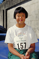 Chinese-American girl, Special Olympics participant. Athlete with Down Syndrome. Berkeley, California.