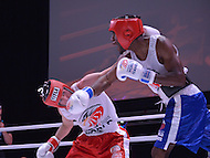 Fairfax, VA - July 1, 2015: Ricardo Johnson (blue trunks) of the DC Fire Department lands a right hand punch to the jaw of Adam Hassan of the Virginia State Police during their boxing bout at the World Police and Fire Games at the George Mason University July 1, 2015.   (Photo by Don Baxter/Media Images International)