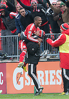 20 April 2013: Toronto FC defender Jeremy Hall #25 celebrates his goal with Toronto FC massage therapist Marcelo Casal during the second half in an MLS game between the Houston Dynamo and Toronto FC at BMO Field in Toronto, Ontario Canada..The game ended in a 1-1 draw...