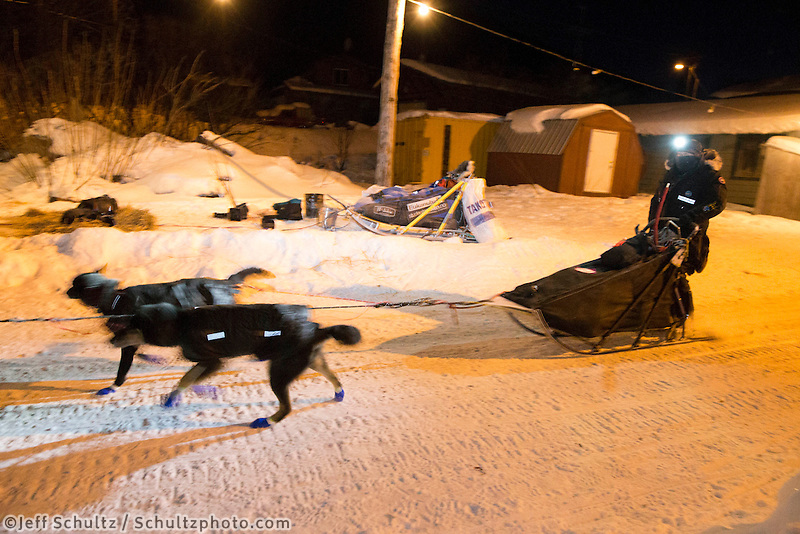 Curt Perano and team run down the road as they leave the Takotna checkpoint after their 24 hour layover on Thursday, March 6, during the Iditarod Sled Dog Race 2014.<br /> <br /> PHOTO (c) BY JEFF SCHULTZ/IditarodPhotos.com -- REPRODUCTION PROHIBITED WITHOUT PERMISSION