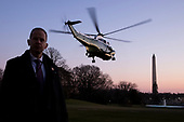 A US Secret Service agent stands by as Marine One departs carrying US President Donald J. Trump en route to a rally in Michigan; on the South Lawn of the White House, in Washington, DC, USA, 18 December 2019. The US House of Representatives is poised to vote on two articles of impeachment against US President Donald J. Trump, for abuse of power and obstruction of Congress. If passed, Trump would become the third US president in history to be impeached. An impeachment would lead to a trial in the US Senate, where a two-thirds vote of approval would be necessary in order to remove Trump as president.<br /> Credit: Michael Reynolds / Pool via CNP