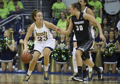 January 26, 2013:  Notre Dame guard Michaela Mabrey (23) dribbles the ball as Providence forward Evi Iiskola (30) defends during NCAA Basketball game action between the Notre Dame Fighting Irish and the Providence Friars at Purcell Pavilion at the Joyce Center in South Bend, Indiana.  Notre Dame defeated Providence 89-44.