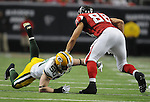 Green Bay Packers linebacker A.J. Hawk tries to tackle Atlanta Falcons tight end Tony Gonzalez during the second quarter of the game at the Georgia Dome in Atlanta, Ga., on Nov. 28, 2010.