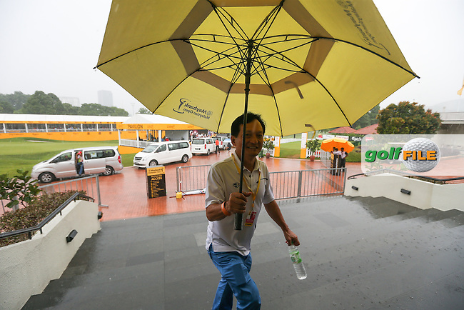 Only a brave soul would venture outside as play is suspended by thunderstorms just after the halfway point during the Final Round of the 2014 Maybank Malaysian Open at the Kuala Lumpur Golf & Country Club, Kuala Lumpur, Malaysia. Picture:  David Lloyd / www.golffile.ie