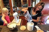 Ella Jacobs, 3, help her mother, Heather, make pancake batter in the kitchen of their Polk City home.  Heather lost her husband, Eric, in a plane crash in 2006 when she was eight months pregnant with Ella and has since been raising her five young children on her own.
