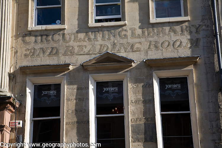 Faded historic building sign for Circulating Library and Reading Room, Milsom Street, Bath, Somerset, England