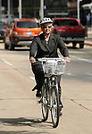 Mayor Annise Parker rides one of the Houston B-cycle bikes outside City Hall Monday April 30,2012. (Dave Rossman Photo)