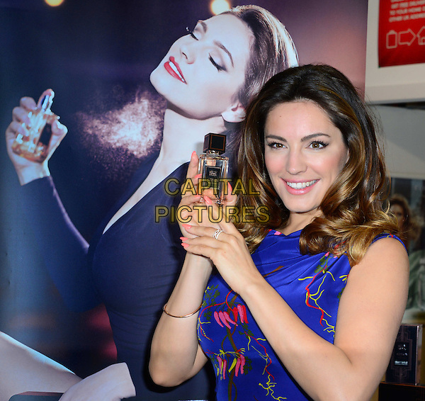 LONDON, ENGLAND - MARCH 17: British TV presenter and model Kelly Brook attends photocall to launch her debut fragrance, Audition at The Perfume Shop, 89 Oxford Street, on March 17, 2014, in London, England.  <br /> CAP/BF<br /> &copy;Bob Fidgeon/Capital Pictures