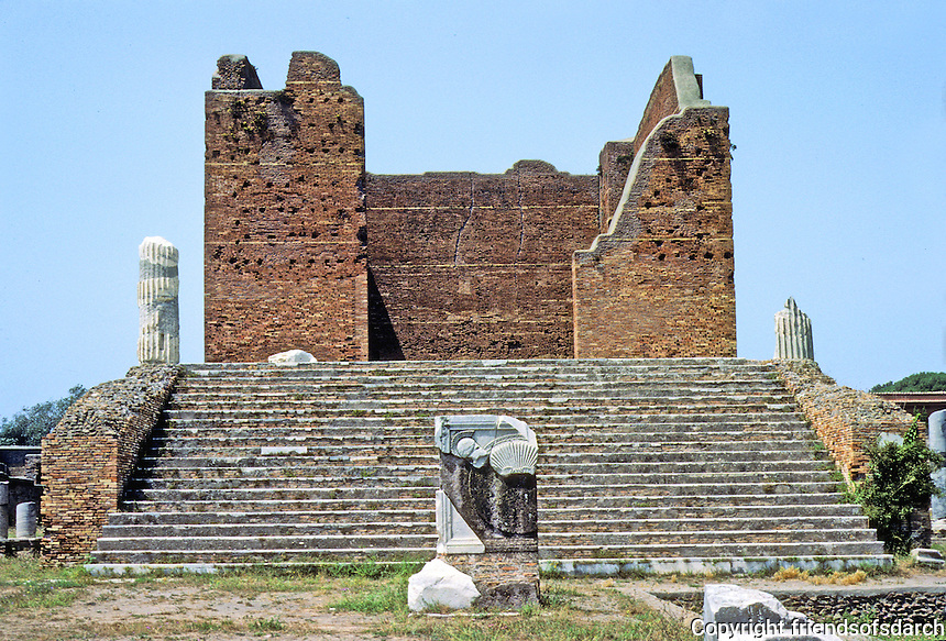 Italy: Ostia--Capitol. Largest temple of Ostia, devoted to Jupiter, Juno and Minerva, 2nd C. Marble facing stripped. Photo '83.
