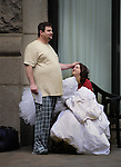 September 30, 2013.Outside the Renaissance Hotel on Sixth Street Downtown, a couple waits for a family member to pick them up following a two night stay after their Saturday wedding. She is holding her wedding dress with the bodice on her lap upside down.