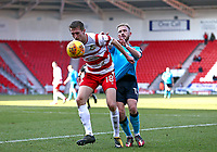 Paddy Madden of Fleetwood Town loses the ball to George Glendon of Fleetwood Town during the Sky Bet League 1 match between Doncaster Rovers and Fleetwood Town at the Keepmoat Stadium, Doncaster, England on 17 February 2018. Photo by Leila Coker / PRiME Media Images.