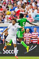 June 07, 2014:  the United States of America forward Chris Wondolowski (18) tries to head the ball while being defended by Nigeria defender Efe Ambrose (5)  during action between the USA Men's National Soccer team and Nigeria at EverBank Field in Jacksonville, Florida.  This is the last match before the USA team leaves for Brazil and the 2014 World Cup Championships. USA defeated Nigeria 2-1.