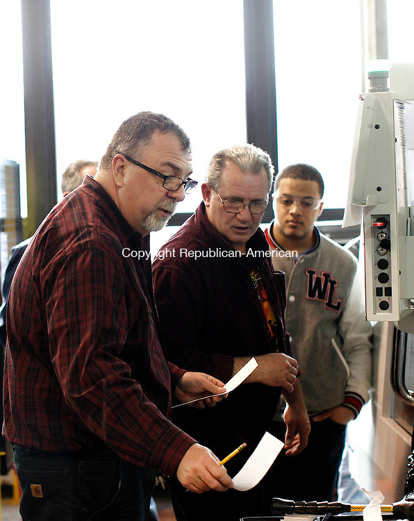 Torrington, CT- 21 March 2013-032113CM03-  Larry Pomerleau, manufacturing technology department head at Olive Wolcott High School assists student, Craig Suttmeier, of Wolcott with a Haas CNC Milling machine during a Northwest Community College class at Wolcott Tech in Torrington Thursday afternoon.  The students are part of an advanced manufacturing program at NCCC, and were taking their finals for the class at Wolcott Tech.  Christopher Massa Republican-American