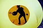 Ball tossing inside of Carsten Höller's art tent in Brooklyn.