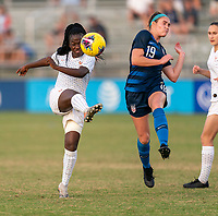 LAKEWOOD RANCH, FL - DECEMBER 11: Grace Kazadi #12 of France shoots past Anna Podojil #19 of the United States during a game between France and USWNT U-20 Red at Premier Sports Campus on December 11, 2019 in Lakewood Ranch, Florida.