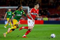 Middlesbrough's Jordan Hugill shields the ball from Preston North End's Daniel Johnson<br /> <br /> Photographer Alex Dodd/CameraSport<br /> <br /> The EFL Sky Bet Championship - Middlesbrough v Preston North End - Wednesday 13th March 2019 - Riverside Stadium - Middlesbrough<br /> <br /> World Copyright &copy; 2019 CameraSport. All rights reserved. 43 Linden Ave. Countesthorpe. Leicester. England. LE8 5PG - Tel: +44 (0) 116 277 4147 - admin@camerasport.com - www.camerasport.com