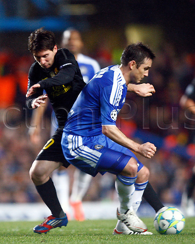 18.04.2012. Stamford Bridge, Chelsea, London. Lionel Messi of  FC Barcelona takes on Chelsea's Frank Lampard during the Champions League Semi Final 1st  leg match between Chelsea and Barcelona  at Stamford Bridge, Stadium on April 18, 2012 in London, England.............