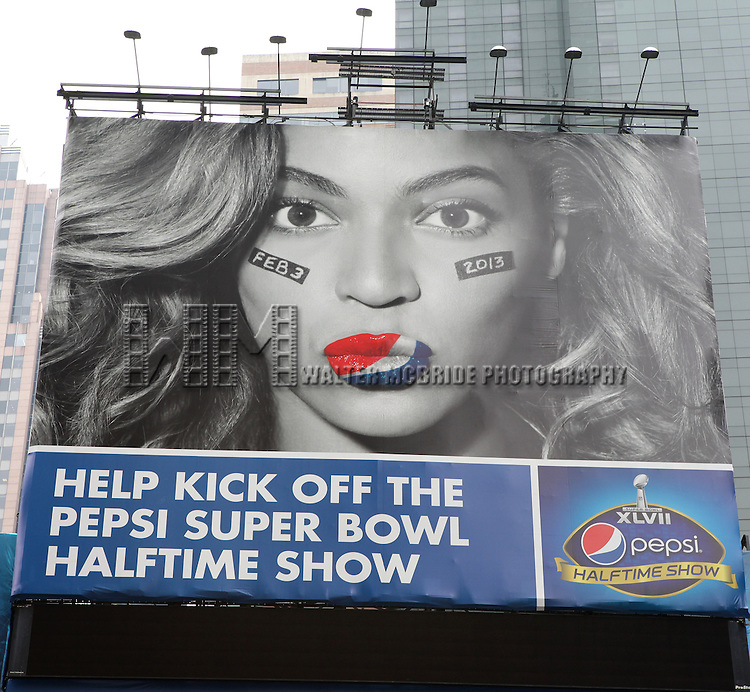 "Beyonce illustrated in the Pepsi Super Bowl Halftime show billboard campaign. The superstar singer has inked a deal with the soft drink giant to become its new ""brand ambassador"" - a deal reportedly worth $50 million. Times Square, New York City on 1/9/2013"