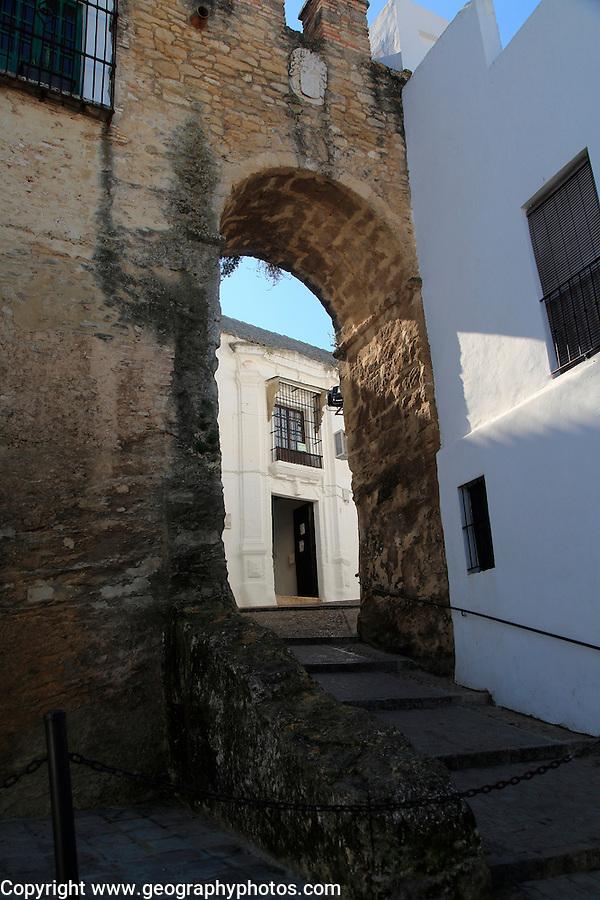 Historic street and castle walls in the village of Vejer de la Frontera, Cadiz Province, Spain