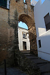 Historic street and castle walls in the village of Vejer de la Frontera, Cadiz Province, Spain