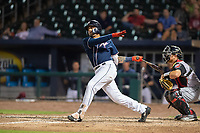 Northwest Arkansas Naturals infielder Emmanuel Rivera (26) connects on a pitch during a Texas League game between the Northwest Arkansas Naturals and the Arkansas Travelers on May 30, 2019 at Arvest Ballpark in Springdale, Arkansas. (Jason Ivester/Four Seam Images)