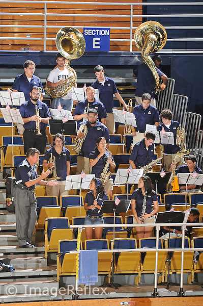 11 September 2011:  FIU's band waits for a break in the action to perform.  The FIU Golden Panthers defeated the Florida A&M University Rattlers, 3-0 (25-10, 25-23, 26-24), at U.S Century Bank Arena in Miami, Florida.