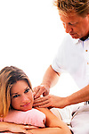 young woman getting shoulder massage by masseur