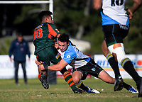 Pakuranga's Obey Samate is tackled during the Auckland Premier club rugby Alan McEvoy Trophy match between Pakuranga and Grammar TEC at Bell Park in Auckland, New Zealand on Saturday, 9 June 2018. Photo: Dave Lintott / lintottphoto.co.nz