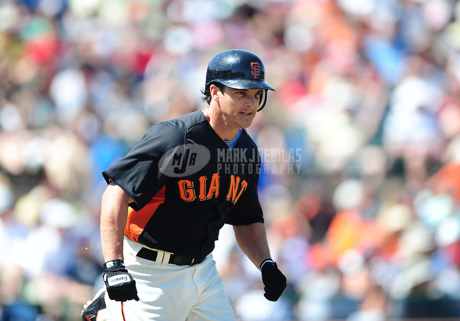 Mar. 28, 2012; Scottsdale, AZ, USA; San Francisco Giants base runner Ryan Theriot runs to first after grounding out in the first inning against the Los Angeles Dodgers at Scottsdale Stadium.  Mandatory Credit: Mark J. Rebilas-