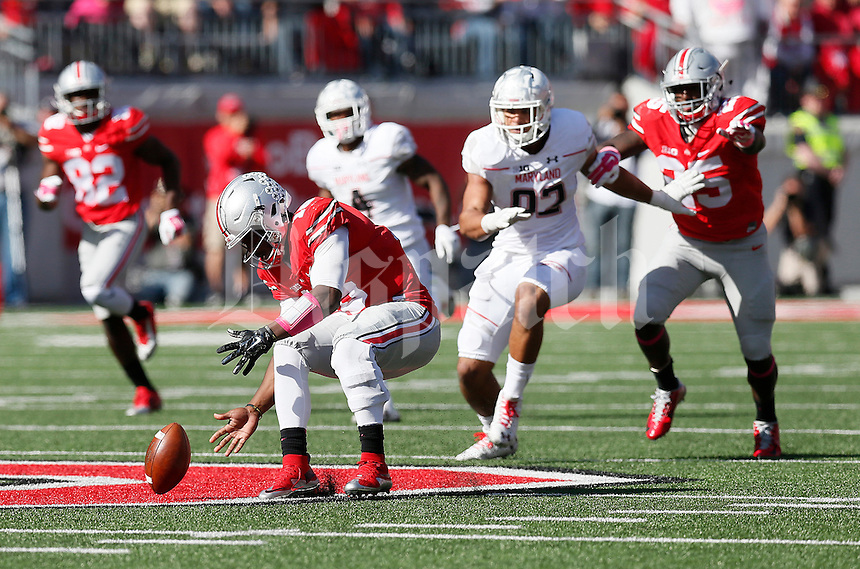 Ohio State Buckeyes quarterback J.T. Barrett (16) scoops up a fumble in the backfield in the fourth quarter of the college football game between the Ohio State Buckeyes and the Maryland Terrapins at Ohio Stadium in Columbus, Saturday afternoon, October 10, 2015. The Ohio State Buckeyes defeated the Maryland Terrapins 49 - 28. (The Columbus Dispatch / Eamon Queeney)