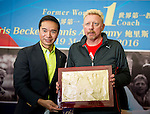 Tennis legend Boris Becker (right) and Mission Hills Vice Chairman Tenniel Chu show Boris Becker's handprint just impressed during the press conference for the opening of Boris Becker Tennis Academy at Mission Hills Resort on 19 March 2016, in Shenzhen, China. Photo by Lucas Schifres / Power Sport Images