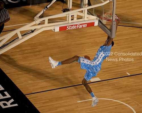 The University of North Carolina's John Henson scores during the Quicken Loans Carrier Classic on Friday, November 11, 2011 aboard the Nimitz-class aircraft carrier USS Carl Vinson (CVN 70) in San Diego, California. Carl Vinson hosted Michigan State University and the University of North Carolina for an NCAA basketball game.  .Mandatory Credit: James R. Evans - U.S. Navy via CNP