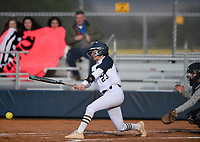NWA Democrat-Gazette/CHARLIE KAIJO Bentonville West High School infielder Kylee Tomlinson (23) hits during a softball game, Thursday, March 13, 2019 at Bentonville West High School in Centerton.