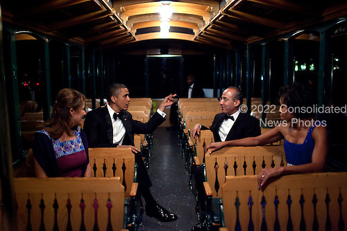 United States President Barack Obama, First Lady Michelle Obama, President Felipe Calderón of Mexico, and his wife, Mrs. Margarita Zavala, ride a trolley to a tent on the South Lawn of the White House, for the State Dinner reception, Wednesday, May 19, 2010..Mandatory Credit: Pete Souza - White House via CNP