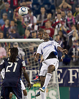 San Jose Earthquakes midfielder Khari Stephenson (7) and New England Revolution defender Darrius Barnes (25) battle for head ball. In a Major League Soccer (MLS) match, the San Jose Earthquakes defeated the New England Revolution, 2-1, at Gillette Stadium on October 8, 2011.
