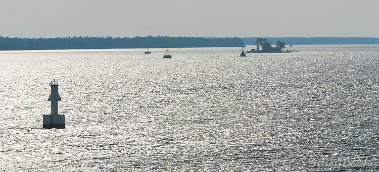 St. Lawrence Seaway channel markers and Crossover Island Lighthouse are silhouetted from my high perch on the roadside cliffs of the 1000 Islands Parkway, Ontario.